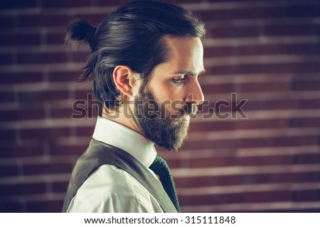 Side view of hamdsome man against wall