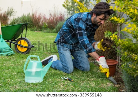 Side view of handsome man gardening