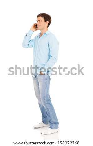 side view of handsome man talking on cell phone on white background - stock photo