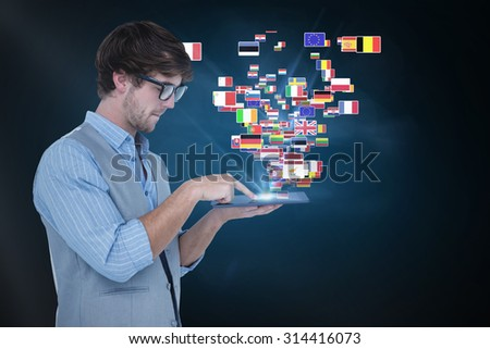 Side view of handsome man using tablet PC against blue background with vignette