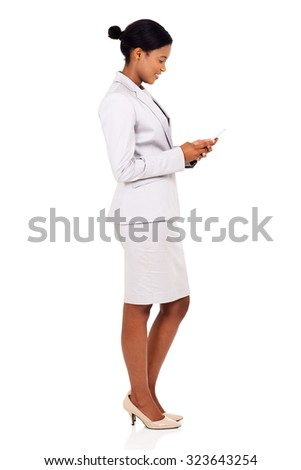 side view of happy african business woman using cell phone isolated on white - stock photo