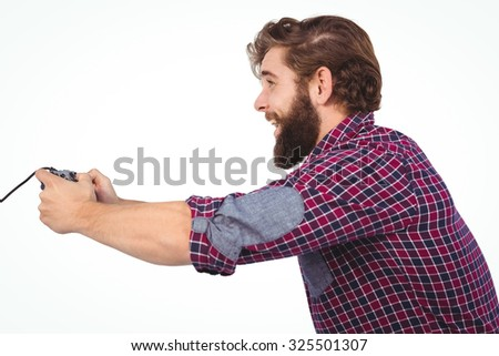 Side view of happy hipster playing video game against white background