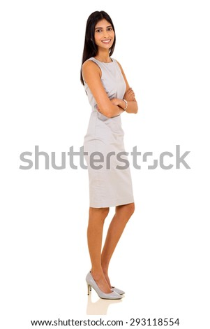 side view of happy indian businesswoman standing on white background - stock photo