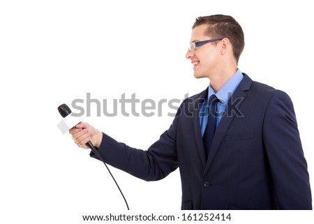 side view of journalist interviewing with microphone on white background - stock photo