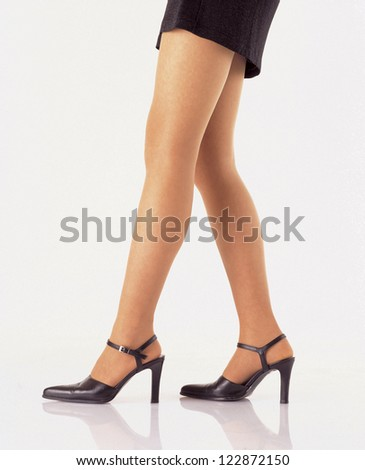 Side view of low section of a woman stepping