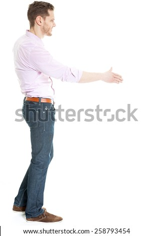 Side view of man offering hand for hand shake - isolated on white