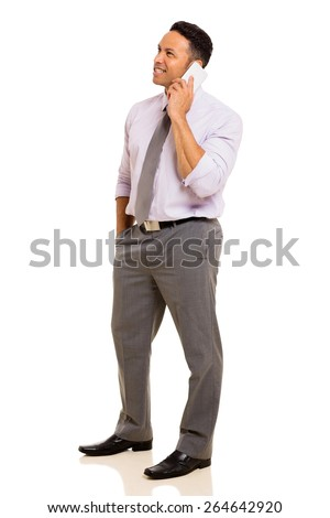 side view of mid age businessman talking on mobile phone - stock photo