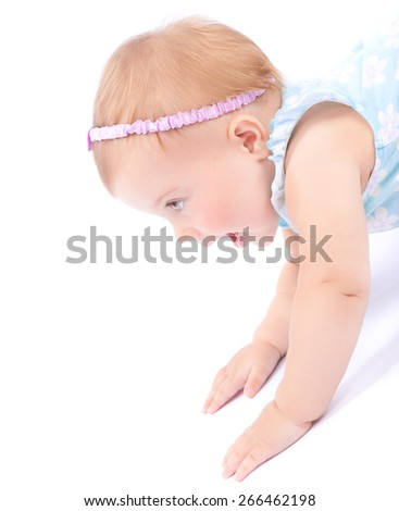 Side view of nice joyful baby girl playing in the studio, isolated on white background, healthy childhood, happiness and enjoyment concept - stock photo