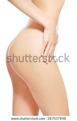 Side view of nude female slim body.