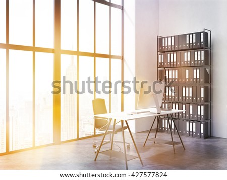 Side view of office interior with computer monitor and lamp on desk, chair, book shelf, concrete floor and window with New York city view. Toned image. 3D Rendering - stock photo