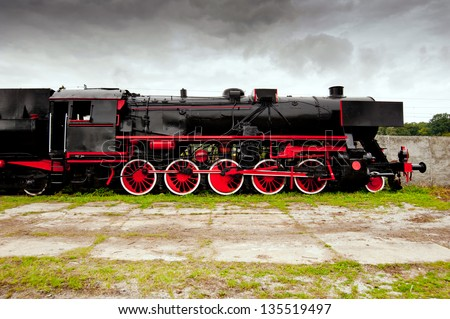 side view of old black, steam locomotive