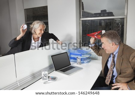 Side view of playful business colleagues in office - stock photo