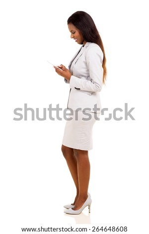side view of pretty african business woman using cell phone isolated on white - stock photo