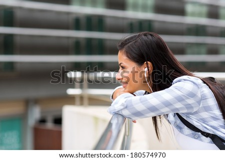 side view of pretty college girl daydreaming - stock photo