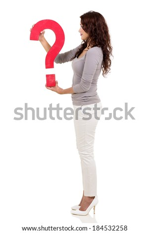 side view of pretty woman holding question mark on white background - stock photo