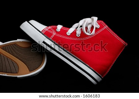 side view of red hi-top basketball shoes - stock photo