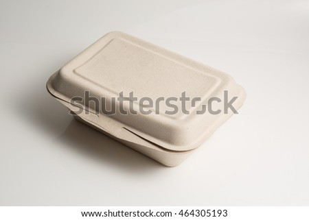 Side view of renewable food container for safe our world on white background / with soft shadow