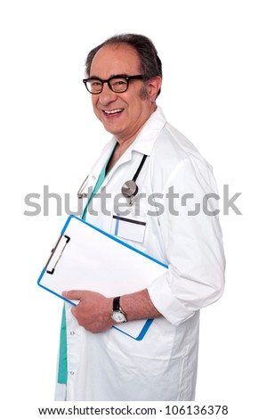 Side view of senior male doctor holding blank clipboard isolated on white background - stock photo