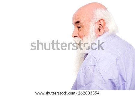 Side view of senior man looking to camera - stock photo