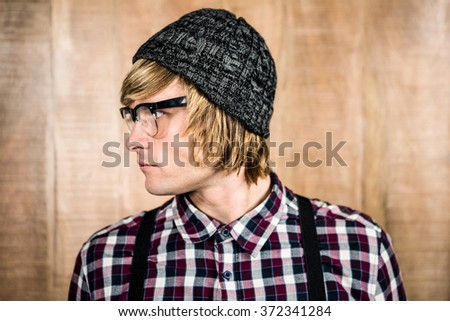 Side view of serious blond hipster looking away