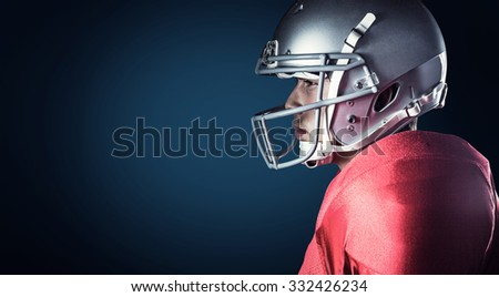 Side view of serious sportsman standing against blue background with vignette