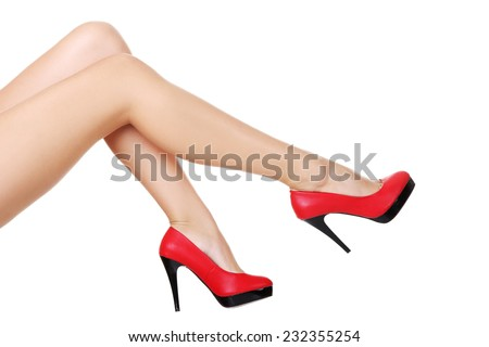 Side view of sexy female legs in high heels.
