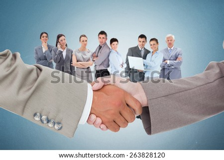 Side view of shaking hands against blue - stock photo