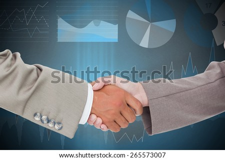 Side view of shaking hands against data interface