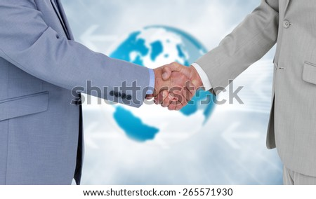 Side view of shaking hands against global business graphic in blue - stock photo