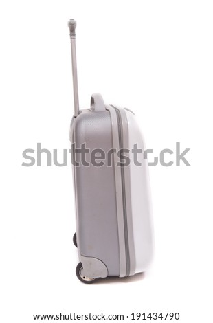 Side view of silver travel suitcase standing over white background - stock photo