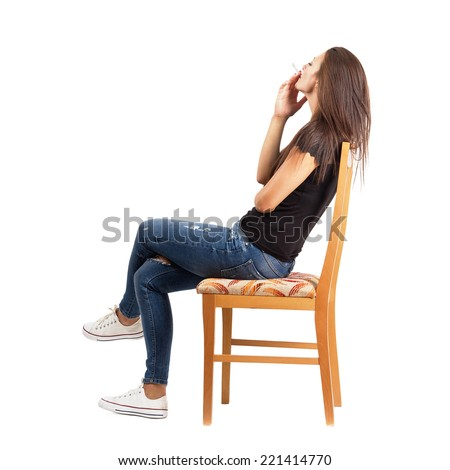 Side view of smoking casual woman sitting on chair. Full body length isolated over white background. - stock photo