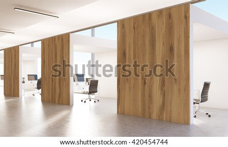 Side view of spacious open office interior with concrete floor and wooden barriers. 3D Rendering - stock photo