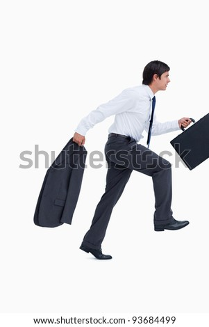 Side view of sprinting businessman with suitcase and jacket against a white background