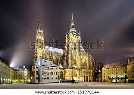side view of St. Vitus Cathedral at winter night, in Prague - stock photo