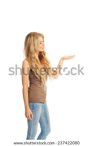 Side view of student woman holding copyspace. - stock photo