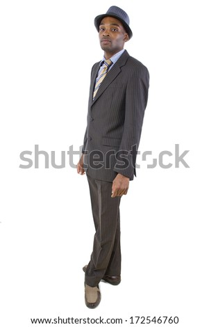 side view of stylish black businessman wearing a hat - stock photo