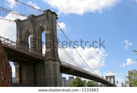 Side view of the brooklyn bridge - stock photo