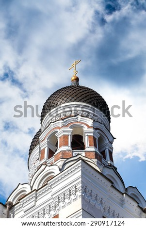 Side view of the dome of Alexander Nevsky Cathedral which is the grandest orthodoxy capula cathedral of Tallinn, on cloudy sky background. - stock photo
