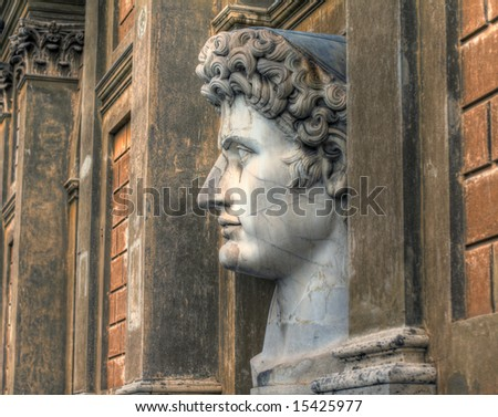 Side view of the head of a very large statue of Roman emperor Marcus Aurelius. Pseudo HDR image created from a single RAW file. - stock photo