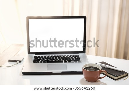 side view of the laptop is on the work table in a Home office with morning light and vintage tone. - stock photo