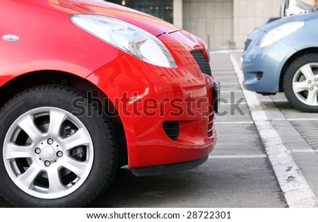Side view of the two new cars standing on the parking lot - stock photo