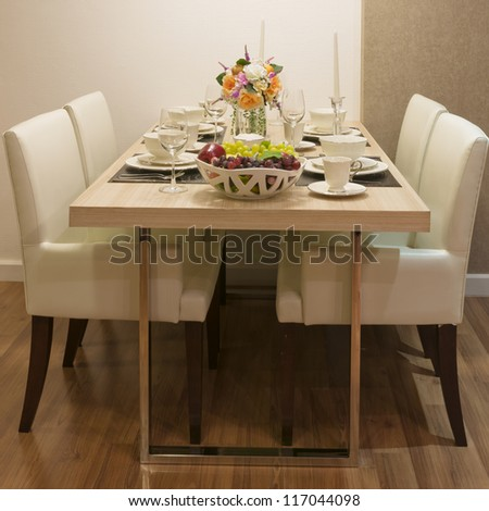 Side view of Top wood Dining Table and White leather chair - stock photo