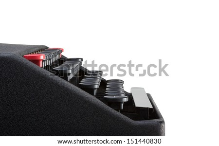 Side view of typewriter keyboard with a white background and clipping path. Plenty of space for copy. - stock photo
