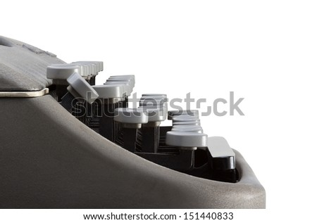 Side view of typewriter keyboard with a white background and clipping path. Plenty of space for copy.