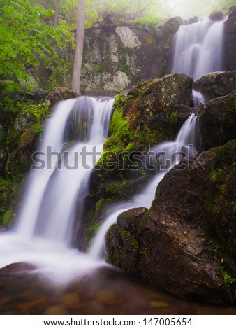Side view of Upper Doyle's River Falls on a spring day in Shenandoah National Park, Virginia. - stock photo