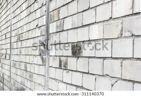 Side view of white brick wall background