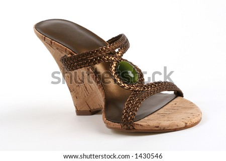 side view of woman's sandal with thick high heel