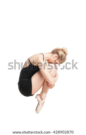 Side view of woman sitting on toes