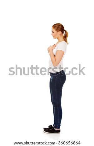 Side view of worried and sad young woman - stock photo