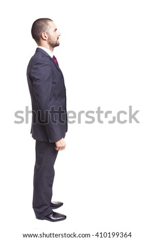 Side view of young businessman, isolated on white background - stock photo